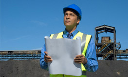 Engineer holding plan